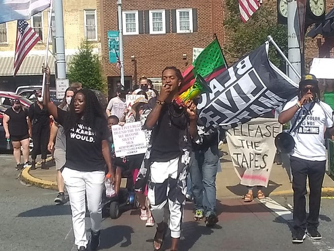 Participants of Saturday's demonstration ended the event with a march around Graham's Court Square.