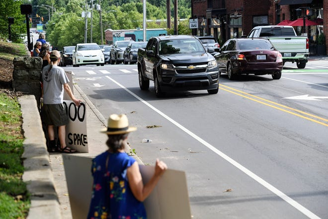 """Members of the Save Charlotte Street group worked withAsheville Coalition for Smart Growthto bring as many cars to the Charlotte Street area as they could for their own """"traffic study"""" July 9, 2021."""