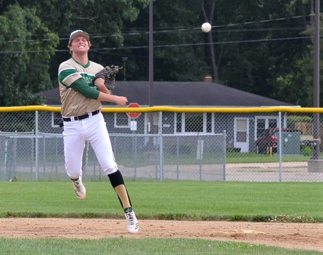 Shortstop Cam Reichel of Shamrocks Gold throws to first during a City Major League Division contest. The City League is celebrating its 90th season this summer.