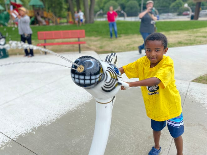 Kayden Wardell, 5, uses a zebra blaster during the unveiling of the Wet Safari Splash Pad at Claude Evans Park on Saturday, July 10, 2021 in Battle Creek, Michigan.
