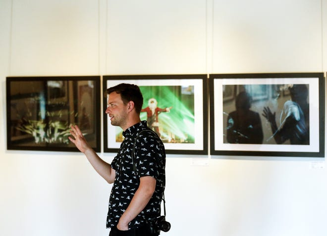 Logan Westom talks about a concert photography exhibit by Rachel Demy, Jered Scott and Ray Duker that was on display this month at Bremerton Canvas, a new exhibit space on Pacific Avenue in downtown Bremerton.