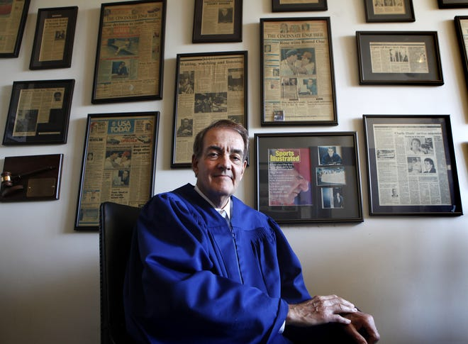 Judge Norbert Nadel photographed in his chambers in 2014, in front of a wall that displays magazine and newspaper articles, most of which concern his controversial decision regarding Cincinnati Reds player Pete Rose in June 1989, which halted MLB's meeting to oust the all-time hit king from the game. His decision was criticized nationally.