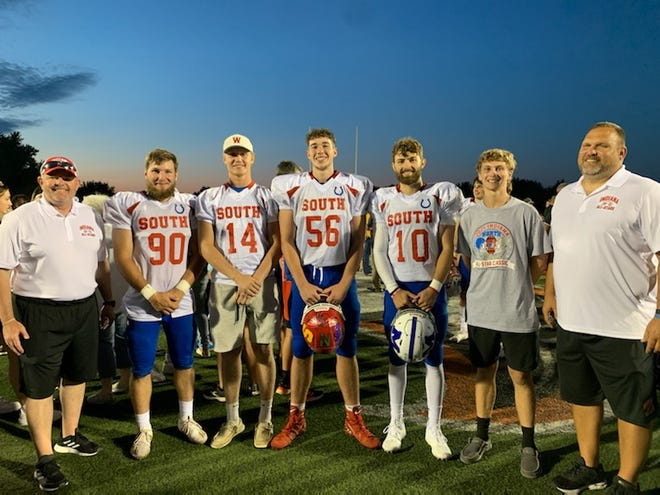 Southwestern Indiana representatives from Friday's IFCA North-South All-Star Classic. From left to right: Assistant coach Joe Morris (Washington), Blake Ritzert (Mount Vernon), Trey Reed (Washington), Dylan Mathena (Tell City), Colton Pence (Memorial), manager Zach Williams (Jasper) and assistant coach Joe Shelton (Jasper).
