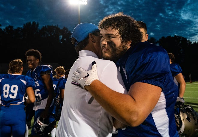 All-Star North Kayden Sowders (39) hugs a coach after playing in the Indiana Football Coaches All-Star Game, Friday, July 10, 2021, at Macholtz Stadium at Anderson University, Anderson. All-Star South won against All-Star North.