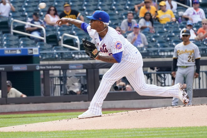 New York Mets starting pitcher Marcus Stroman delivers during the first inning of the first baseball game of a doubleheader against the Pittsburgh Pirates, Saturday, July 10, 2021, in New York. (AP Photo/Mary Altaffer)