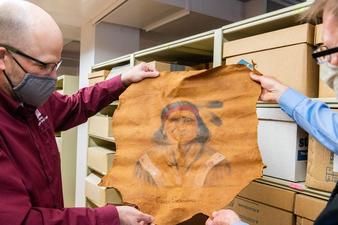 Dylan McDonald (left), New Mexico State University political papers archivists and special collections librarian, and Dennis Daily, NMSU Archives And Special Collections department head, review an artifact in the Wendell Chino collection. In 2017, Mark Chino and his wife, Selena, donated the Wendell Chino papers to the NMSU's Archives and Special Collections.