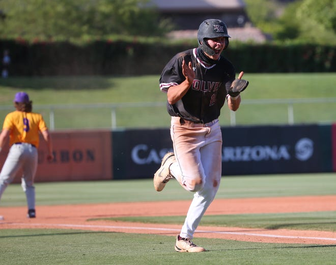 Desert Mountain's Wes Kath (10) celebrates while scoring against Sunrise Mountain during the 5A baseball state championship game in Tempe, Ariz. May 17, 2021.