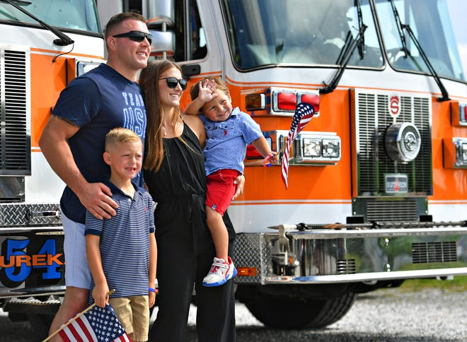 Clockwise from top left, Team USA Olympic athlete and U.S. Marine Corps SSgt. John Stefanowicz, poses for a photo with wife Samantha, and sons Colton, 3, and Connor, 6, all of Jacksonville, N.C., as community members prepare to celebrate Stefanowicz during the Hometown Olympic Sendoff parade beginning in Hopewell Township, Saturday, July 10, 2021. The Olympic athlete will leave next week for the Olympic Games in Tokyo. Dawn J. Sagert photo