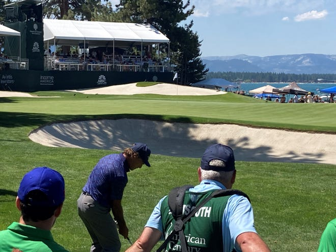 Doug Flutie hits onto the green at No. 17 at Edgewood Tahoe on Saturday.