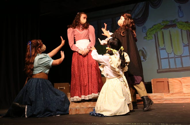 """Actors perform a dress rehearsal for the play """"Little Women"""" for family members at the Ice House Theater in Visalia on July 9, 2021."""