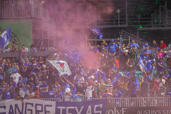 Cruz Azul fans release pink smoke during a match at Bold Stadium at Circuit of the Americas on Saturday. Cruz Azul defeated the Austin Bold FC 1-0 in an exhibition match.