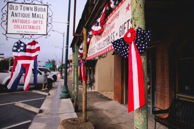 Buildings are decorated in flags and patriotic bows on Main street in Buda, Texas on July 4.