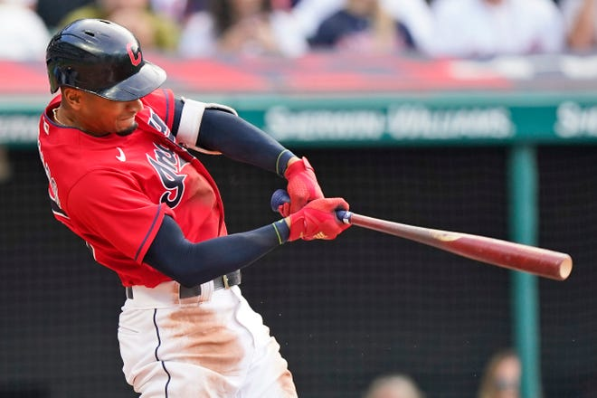 Cleveland's Oscar Mercado hits an RBI-single in the fourth inning of a baseball game against the Kansas City Royals, Saturday, July 10, 2021, in Cleveland. (AP Photo/Tony Dejak)