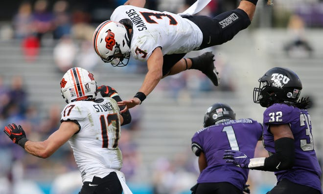 Oklahoma State quarterback Spencer Sanders had his ups and downs last season. He's entering his third year as the Cowboys' starter but must cut down on turnovers. Last season, he threw 14 touchdown passes but also threw eight interceptions.