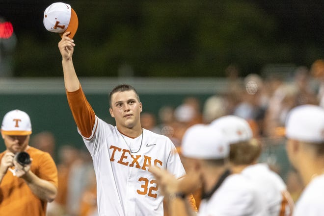 Texas pitcher Ty Madden salutes the fans during a game against South Florida in Austin on June, 12. Madden was selected in the first round of the MLB draft on Sunday evening.