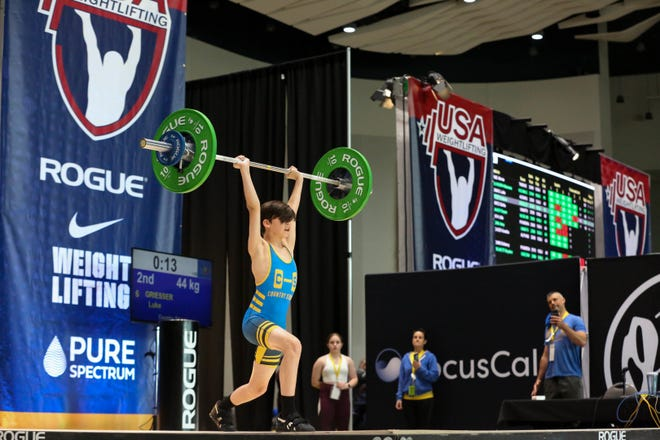 Luke Griesser of County Strong gym works to complete his lift at the 2021 USA Weightlifting Youth National Championships in Detroit.