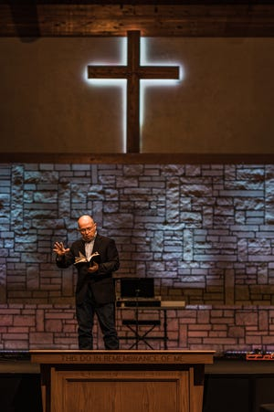 Dr. Russell Hosey at First Church of the Nazarene preaching on Sunday morning.