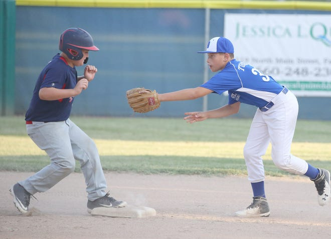 Boonville 10-year-old second baseman Kyran Turner attempts to apply the tag on a player from Dexter Thursday night in the Cal Ripken State Tournament at the COCOBA ballfield. Boonville won 14-4 in four innings.