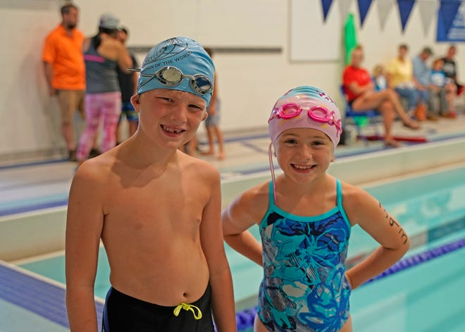 Landon Zehringer, left, and Sydney Judson, both 7 and from Adrian, are ready for the swimming competition Saturday at Adrian High School during the 13th annual Frank and Shirley Dick Family YMCA Splash and Dash.