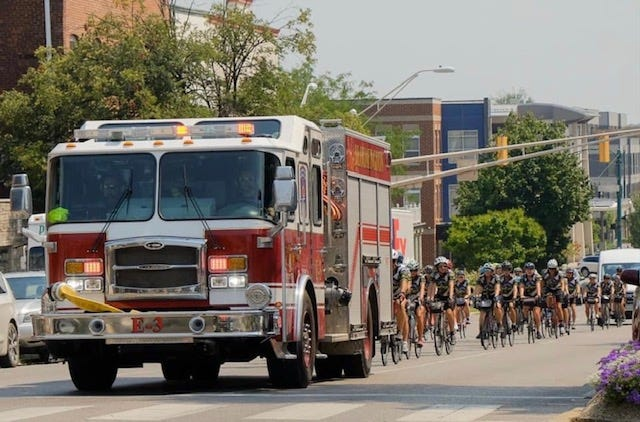 DeCycles student cyclists arrived home accompanied by a Bloomington Fire Department engine escort on July 5.