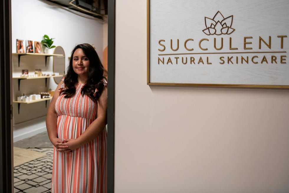 Xochitl Stafford poses for a portrait outside of her new storefront in the Sunbeam building on Sunday, July 11, 2021. Stafford started creating the products in her basement, eventually moving to one-day markets and online sales.