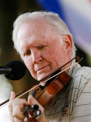 In this 2008 photo, Byron Berline plays at the Oklahoma International Bluegrass Festival in Guthrie