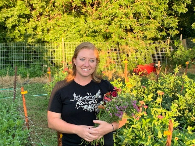 Ema Wood, from near Trousdale, grows her own flowers and pumpkins to supply a growing art business with many customer options.