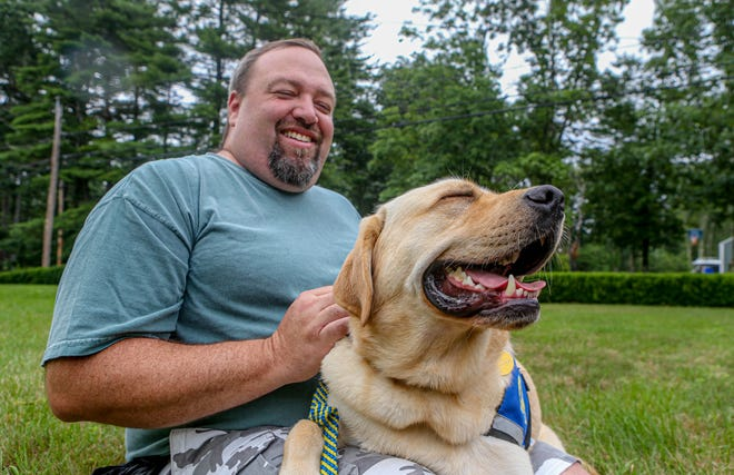 Non-combat veteran Randall Shaw with his therapy dog Smitty.