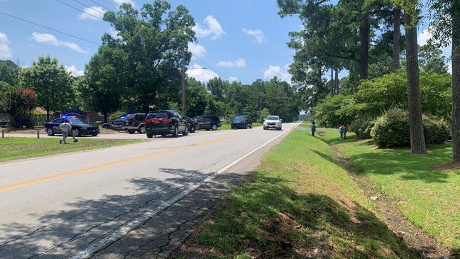 Multiple police officers on the scene at the shooting on the road of Hunter's Landing apartment complex. Photo obtained from Spot the Lesson News website.