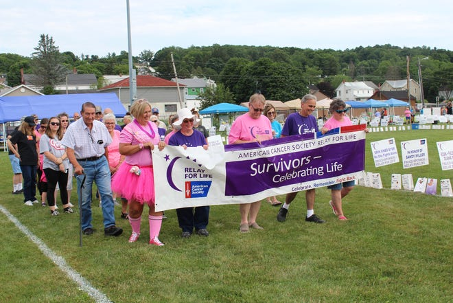 Survivors of cancer walked around the field at Salisbury-Elk Lick Schools during the Survivor lap at Relay For Life Saturday.