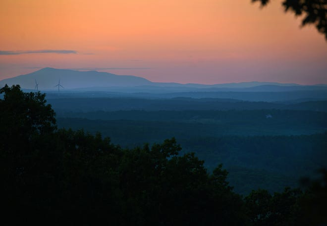 PRINCETON - Although the gates of the Wachusett Mountain State Reservation close at sunset, people could drive up to a nearby lookout to view foggy layers and windmills next to Mount Wachusett Community College in Gardner with New Hampshire's Mount Monadnock looming in the background Saturday.