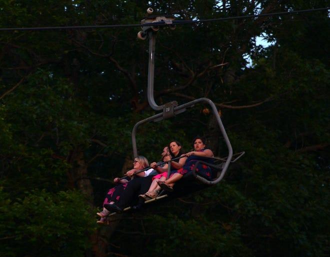 PRINCETON - People ride the gondola down to Wachusett Mountain ski area after a wedding Saturday.
