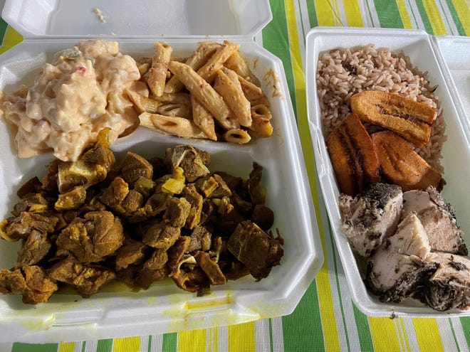 Menu selections at Dulcie's Cafe include curry goat with sides (left) and jerk chicken with sides.