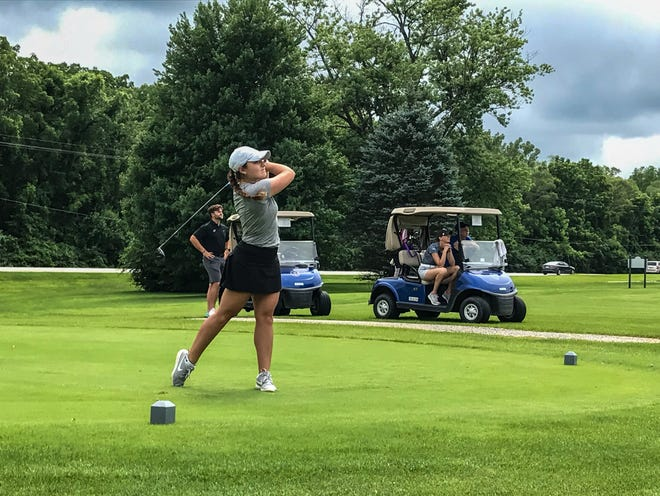 Ally Ross watches her tee shot on the 18th hole in the championship round of the Women's City golf tournament at West Lafayette Golf and Country Club.