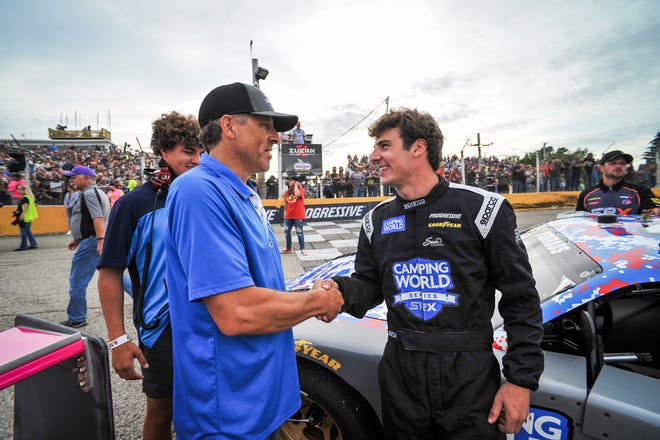 Slinger Speedway owner Todd Thelen wishes good luck to Luke Fenhaus, winner of the 42nd Slinger Nationals, before the Superstar Racing Experience event at Slinger in July.