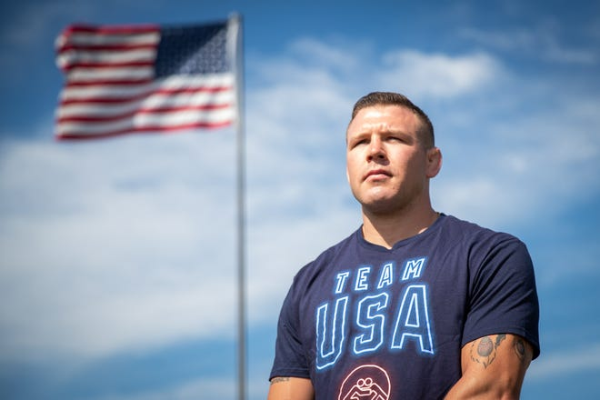 Team USA Olympic wrestler Staff Sgt. John Stefanowicz poses for a portrait at his family's home before a send-off parade for Stefanowicz, Saturday, July 10, 2021, in Hopewell Township.
