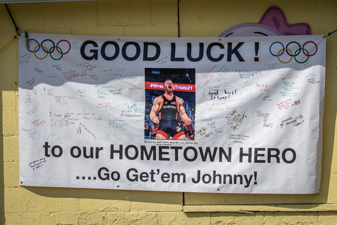 A sign bids good luck with numerous signatures during a send-off parade for Team USA Olympic wrestler John Stefanowicz, Saturday, July 10, 2021, in Stewartstown.