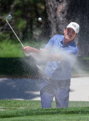 Vinny Del Negro hits out of a bunker on the 16th hole during the ACC Golf Tournament at Edgewood Tahoe Golf Course in South Lake Tahoe on Sunday.
