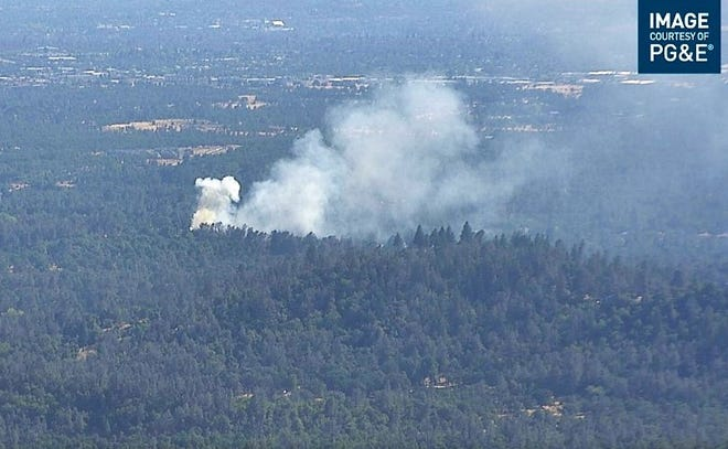 A half-acre fire burned Saturday evening, July 10, 2021, at Old Oregon Trail and Paso Robles Lane north of Redding. A car caught fire and the flames spread to vegetation.