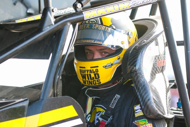Mark Dobmeier sits in his sprint car prior to hot laps on Thursday, July 8 in Grand Forks, N.D.