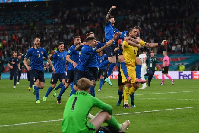 Italian players celebrate after the penalty shootout of the Euro 2020 soccer final match against England.