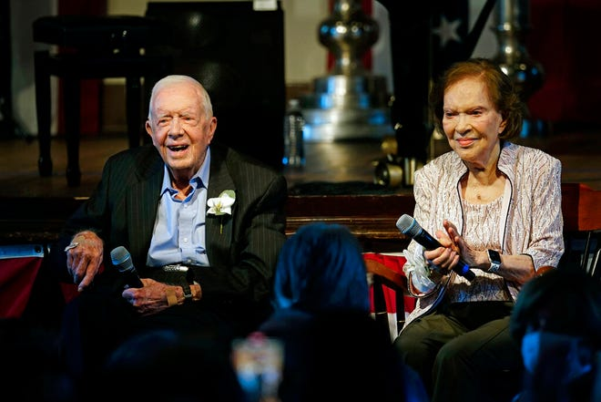 Former President Jimmy Carter and his wife former first lady Rosalynn Carter sit together during a reception to celebrate their 75th wedding anniversary on July 10, 2021, in Plains, Georgia.