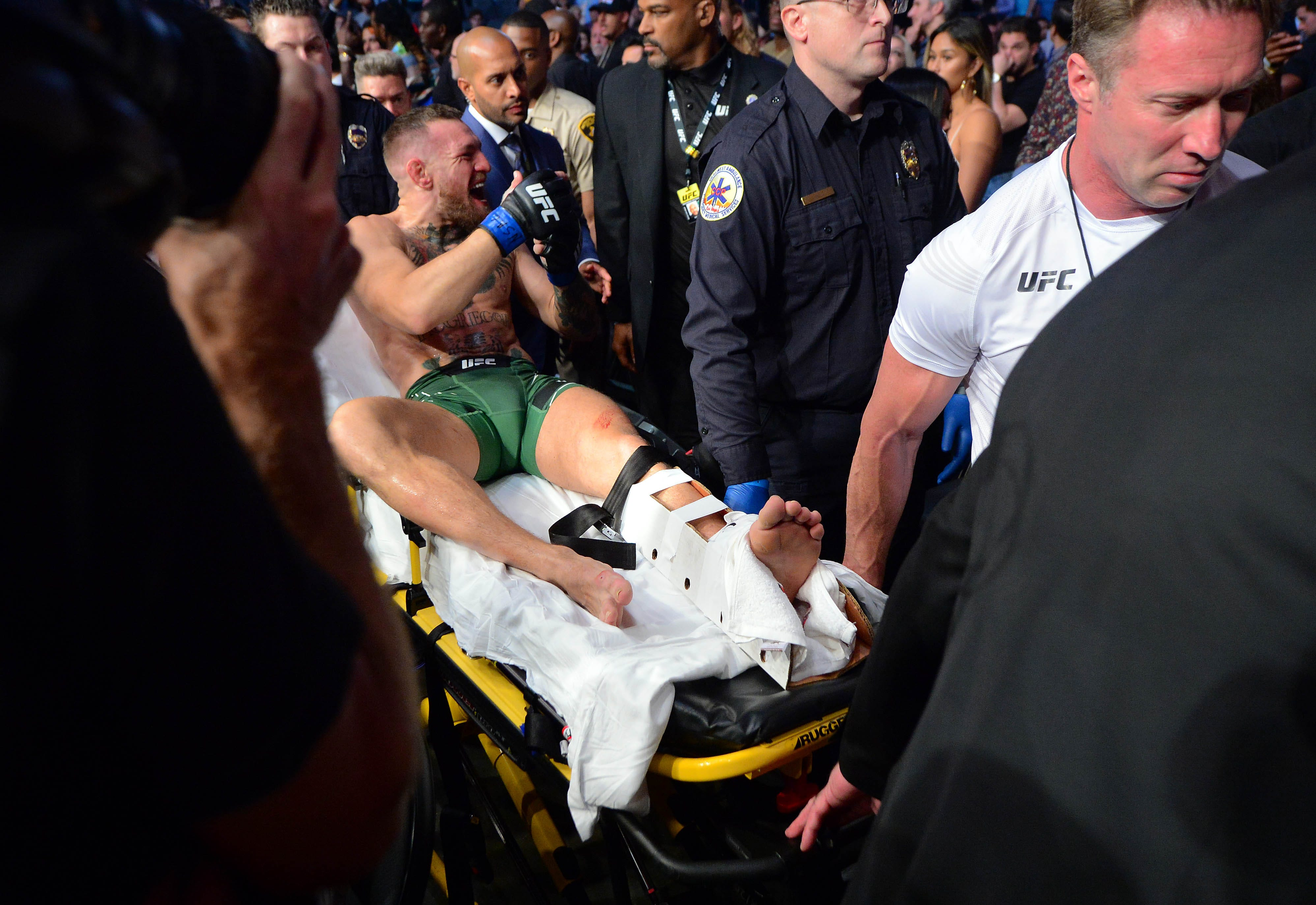 Poirier gets TKO win via doctor s stoppage as McGregor suffers gruesome injury