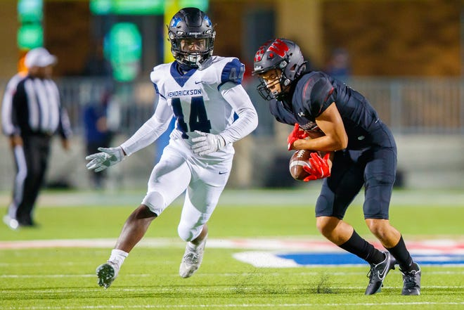 Hendrickson Hawks linebacker Ethan Bell, left, chases down Weiss Wolves wide receiver Price Morgan in a district game last season. Bell returns as the most experienced player on the Hawks' defense.