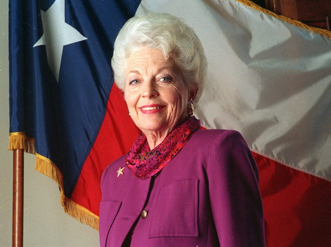Gov. Ann Richards, shown in 1992 with the Texas state flag, believed in compassionate government you could trust, writes a former staffer on the 30th anniversary of her inauguration.