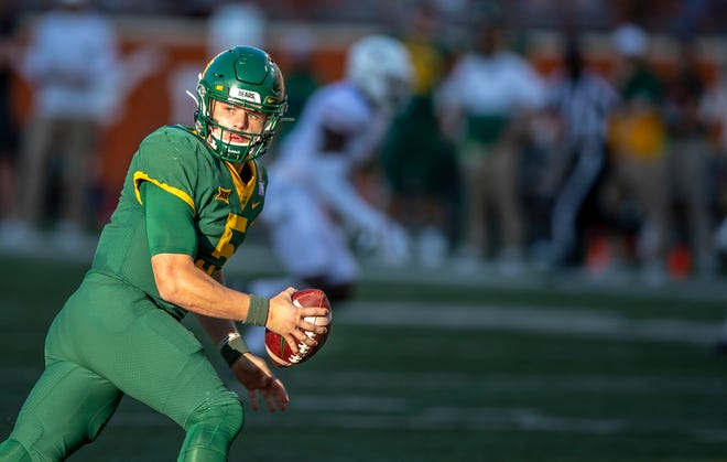 Baylor Bears quarterback Charlie Brewer looks for room to run against Texas Longhorns Oct. 24 at Darrell K Royal-Texas Memorial Stadium. Brewer, a Lake Travis graduate who spent four seasons as Baylor's starting quarterback, has transferred to Utah for his final collegiate season.