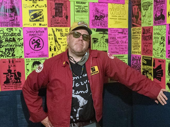 This photo from May 20, 2021 shows Georgia-based journalist and art curator Henry Owings in the green room at 529 Bar in Atlanta, where the walls are decorated with music flier reproductions from Owings' archives.