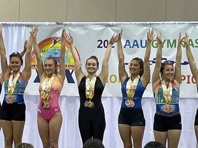 Brianna Schluneker, center, a senior at West Branch, was the AAU nationals platinum level champion.