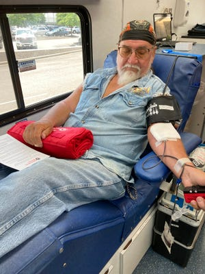 Joe Wetherbee of Hephzibah donates blood during a mobile drive at Augusta Regional Airport held by Shepeard Community Blood Center.