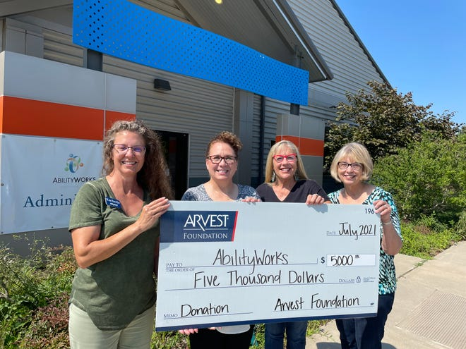 Arvest commercial banker Rachelle Wilson presented the check to Becky Ingram, AbilityWorks CEOP, along with board members Janie Kirkpatrick and Andy Novak.